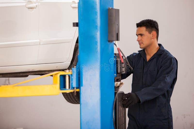 Lifting A Car At An Auto Shop Royalty Free Stock Image