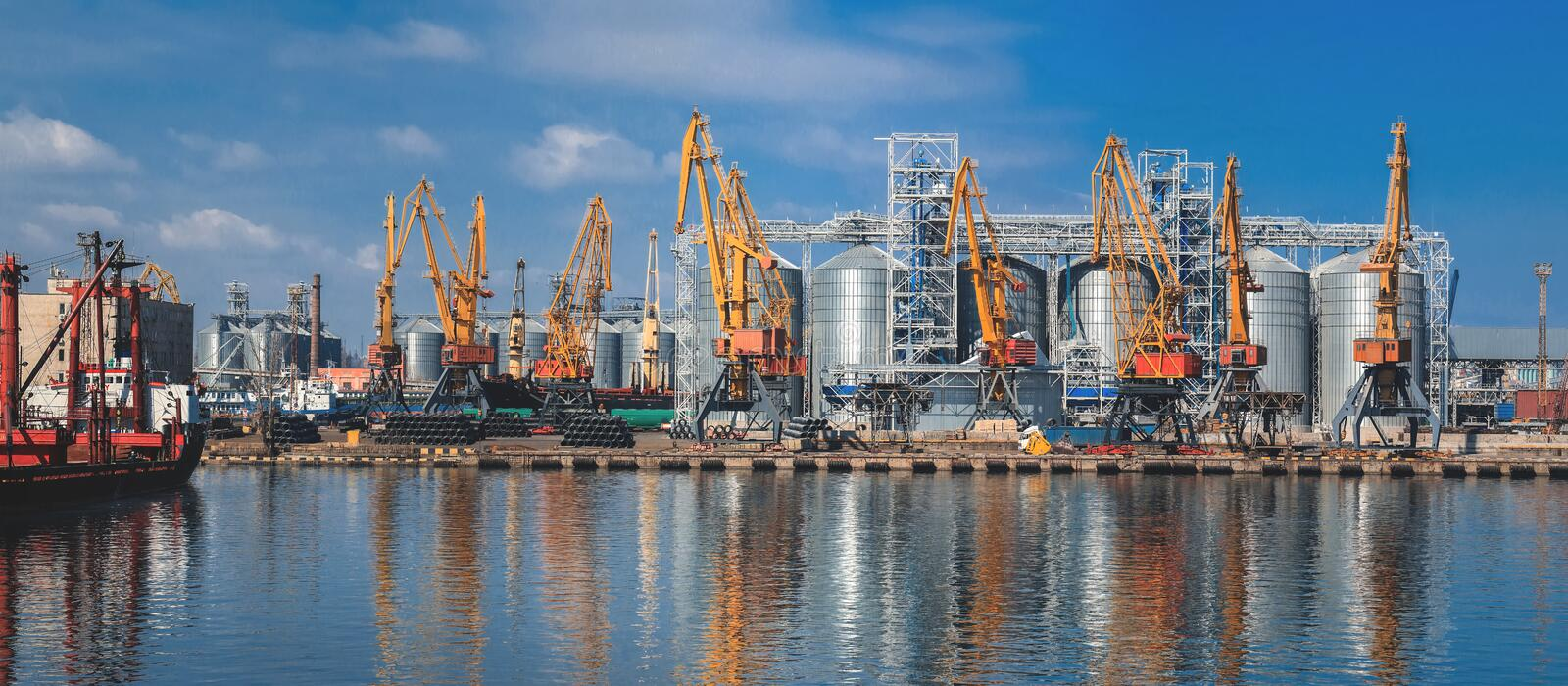 Lifting cargo cranes, ships and grain dryer in Sea Port. Of Odessa, Black Sea, Ukraine stock photos