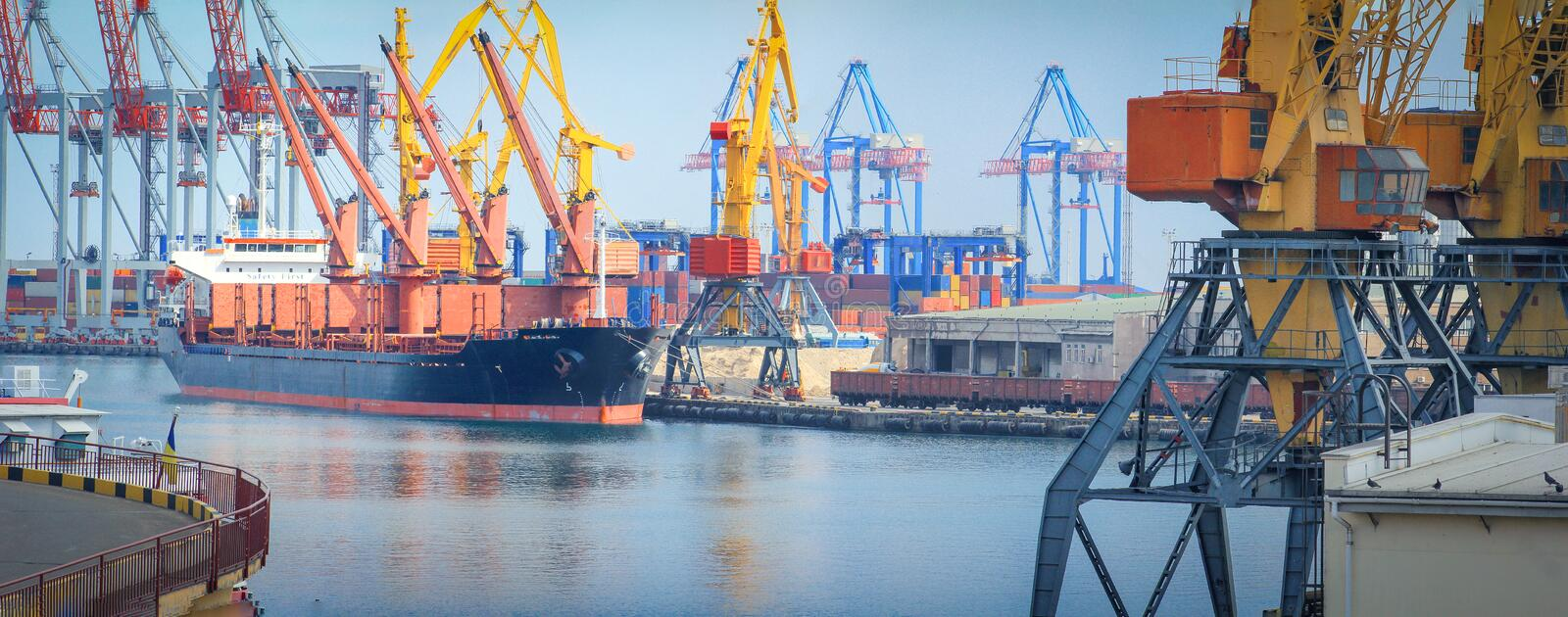 Lifting cargo cranes, ships and grain dryer in Sea Port stock image