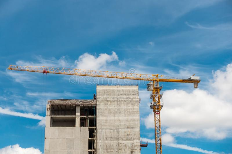 Lifting crane in construction site, Tower crane, Under construct. Ion stock photo