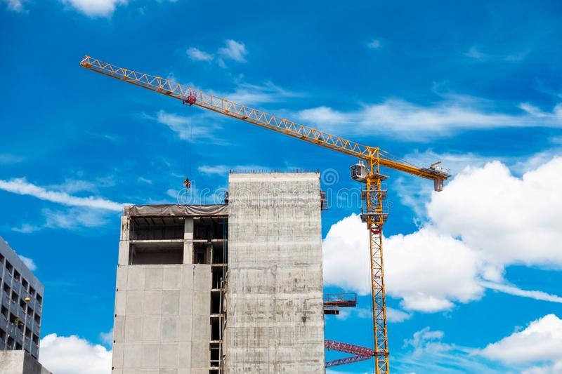 Lifting crane in construction site, Tower crane, Under construct. Ion stock image