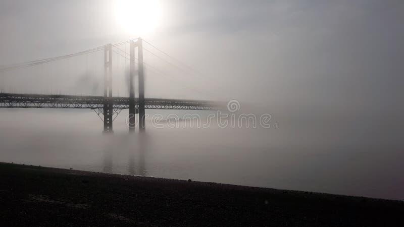 Lifting foggy Morning. Bridge, sunrise, water, morning, nature, awesome royalty free stock photography