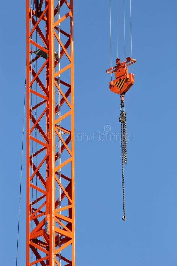Lifting hook. Of revolving tower crane against blue sky stock photo