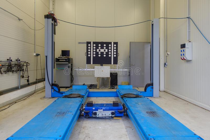 A lifting platform in a car repair shop. A blue lifting platform for cars in a workshop royalty free stock image
