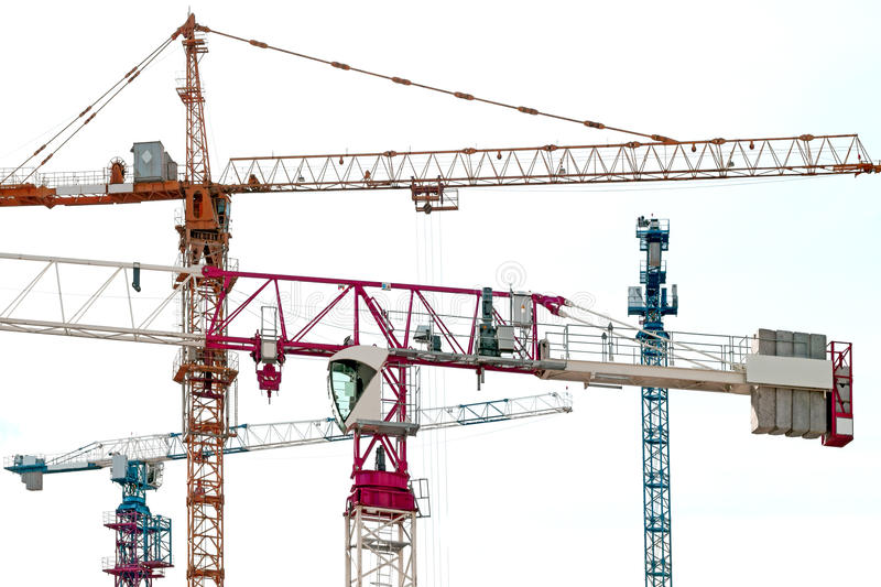 Lifting tower cranes. Against the sky stock image