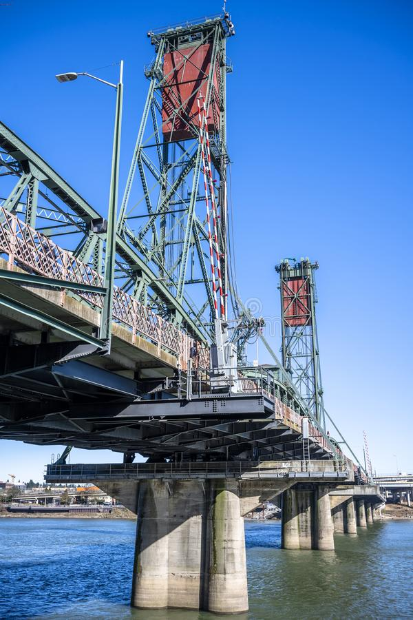Lifting truss Hawthorne bridge with two towers across the Willamette River in the center of Portland Oregon. Sectional Arched Metal truss Hawthorne stock photo