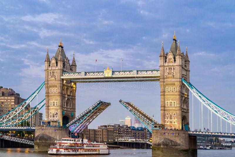 Lifting up London Tower Bridge. London Tower Bridge lifting up at Sunset dusk, London UK stock photo