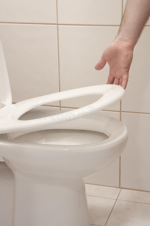 Download Lifting up toilet seat stock image. Image of hand, commode - 13626013