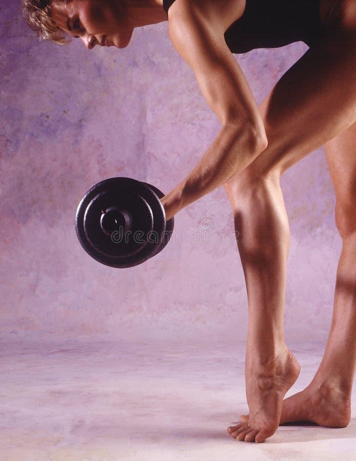 Lifting Weight. Woman lifting barbell
