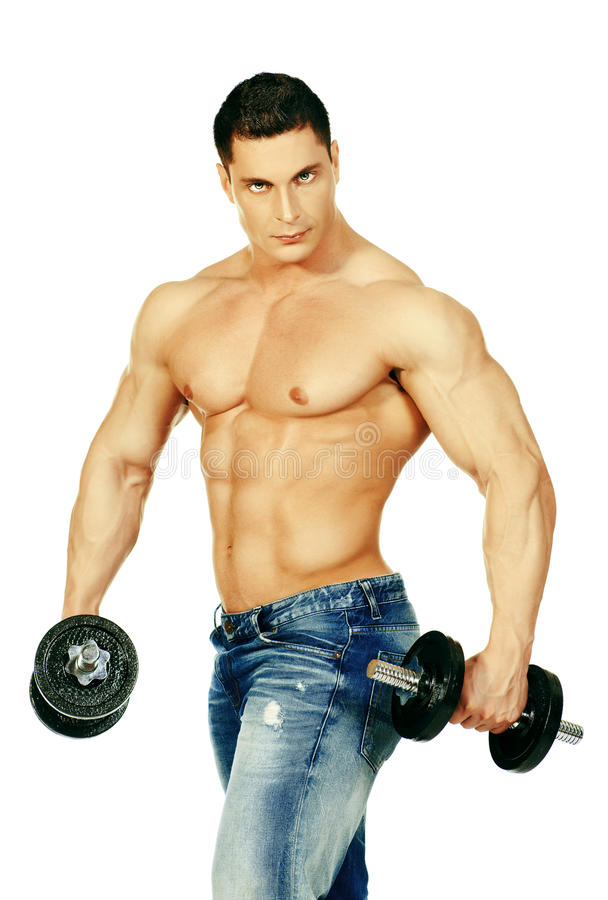 Lifting weights. Portrait of a handsome muscular bodybuilder posing with dumbbell. Isolated over white background royalty free stock images