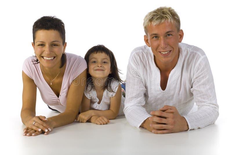 ligga för familj fotografering för bildbyråer
