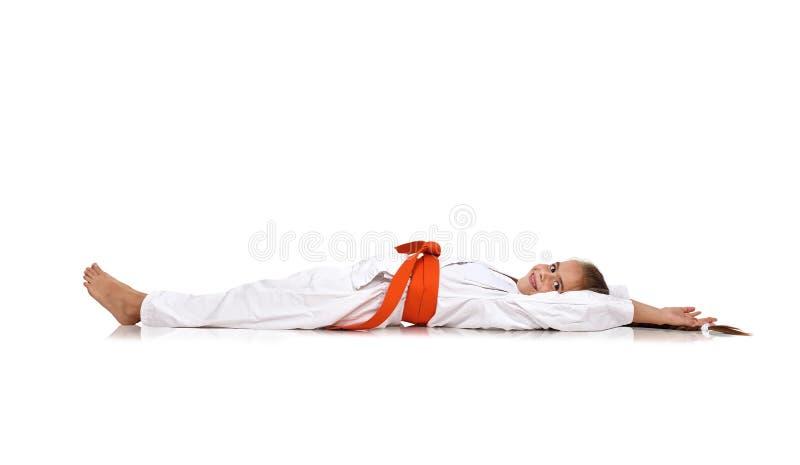 Ligga för karateflicka royaltyfria bilder