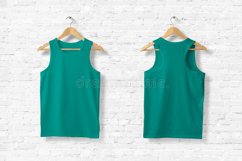Ligh Green Tank Top Mock-up hanging on white wall. royalty free illustration