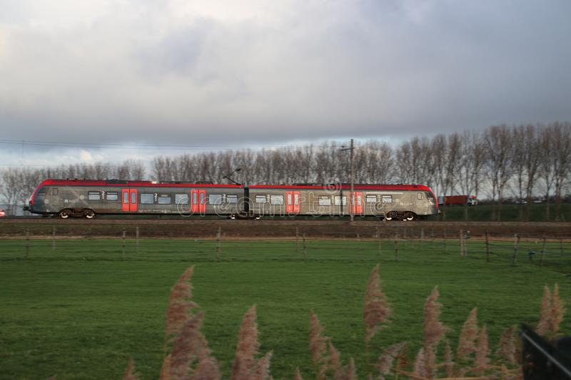 Lighrail RNET flirt train at railroad track between Gouda and Waddinxveen at Moordrecht royalty free stock photo