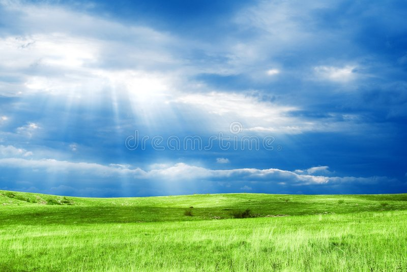 Light above a field stock photography