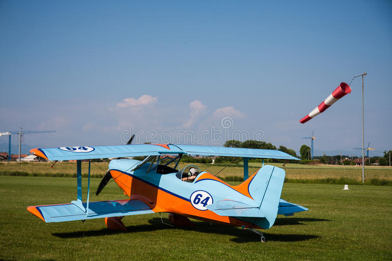 Light aircraft, modern biplane orange and blue. Details and takeoff stock photos