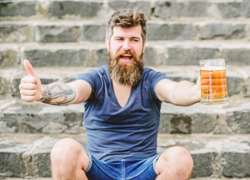 Light ales or dark stouts drink them all. Cafe summer terrace. Guy having rest with cold draught beer. Hipster relaxed. Drinking beer outdoor. Man with beard royalty free stock photography
