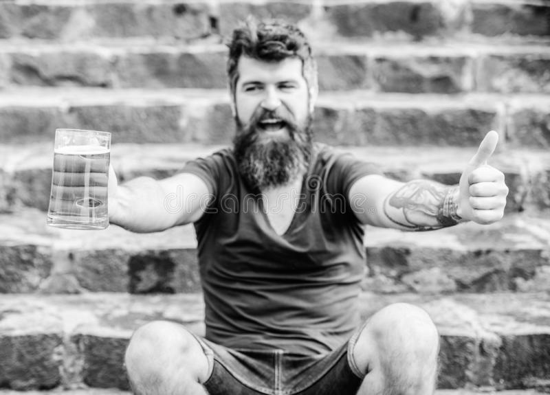 Light ales or dark stouts drink them all. Cafe summer terrace. Guy having rest with cold draught beer. Hipster relaxed. Drinking beer outdoor. Man with beard royalty free stock photos