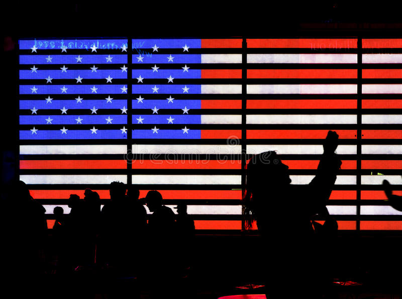 Light American Flag. Bright American flag with silhouettes of people royalty free stock photography
