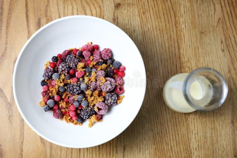 Frozen fruits with granola and yogurt, healthy fruit breakfast stock photo