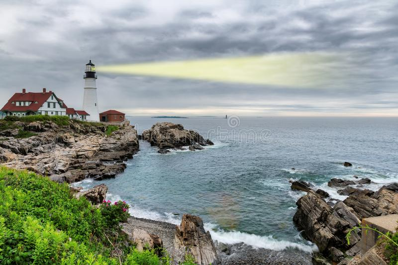 Light beam of Portland Lighthouse in Cape Elizabeth, Maine, USA stock image