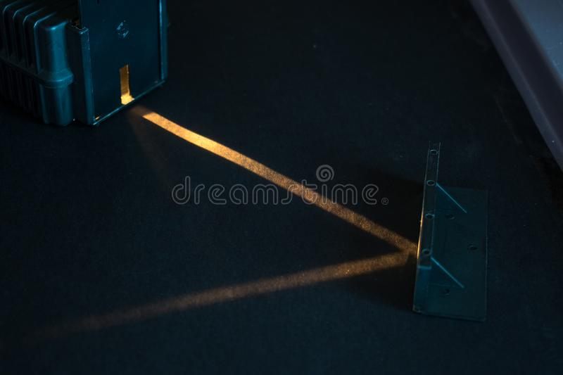Optical experiment. Demonstration of reflection of a light beam in a mirror. royalty free stock photo