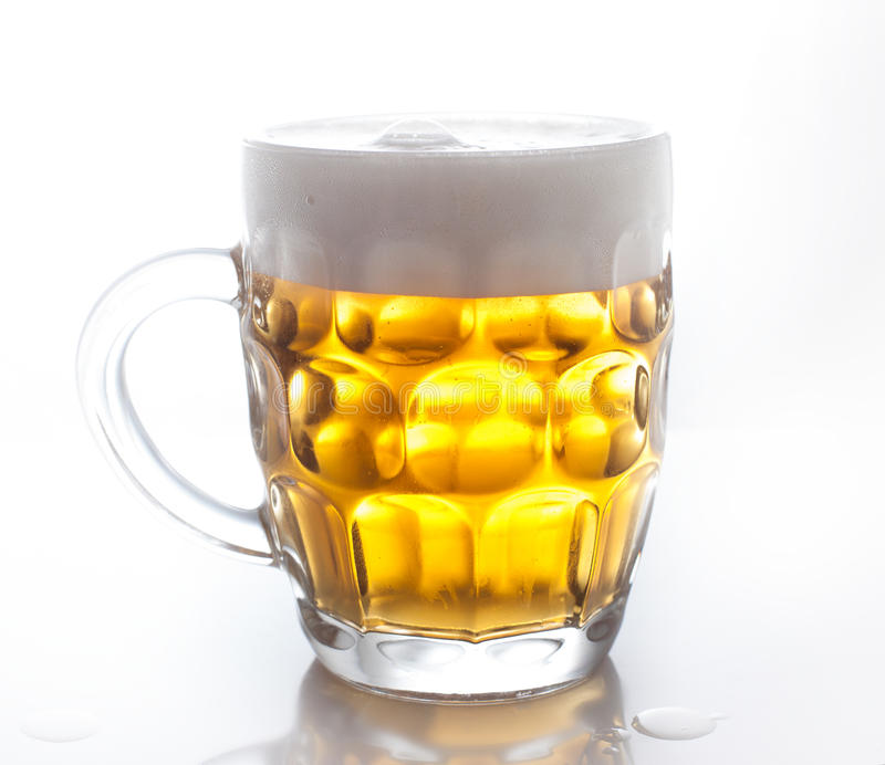 Light beer. Frosty glass of light beer royalty free stock photo