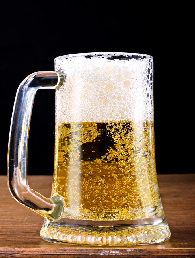 Download Light Beer In A Glass Pint Mug Served On A Wooden Stock Photo - Image: 13426540