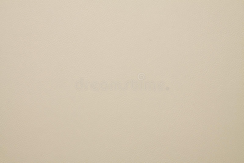 Artificial leather texture Light beige color. In high resolution royalty free stock photography