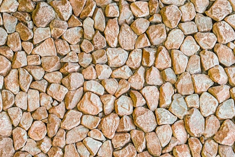 Light beige granite stone background hard uneven surface base urban design monochrome base mini stones stock image
