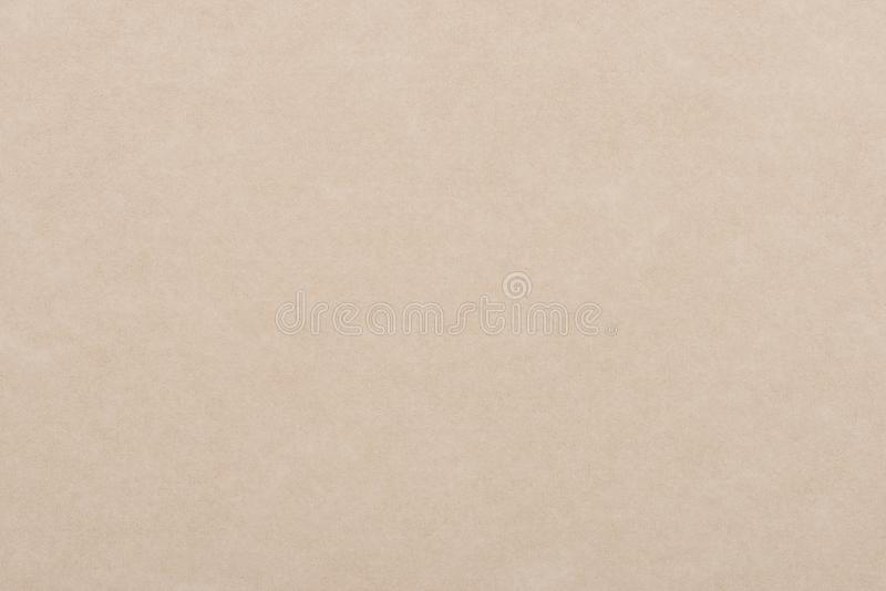 Light beige paper background. Textured sheet from an old book. stock images