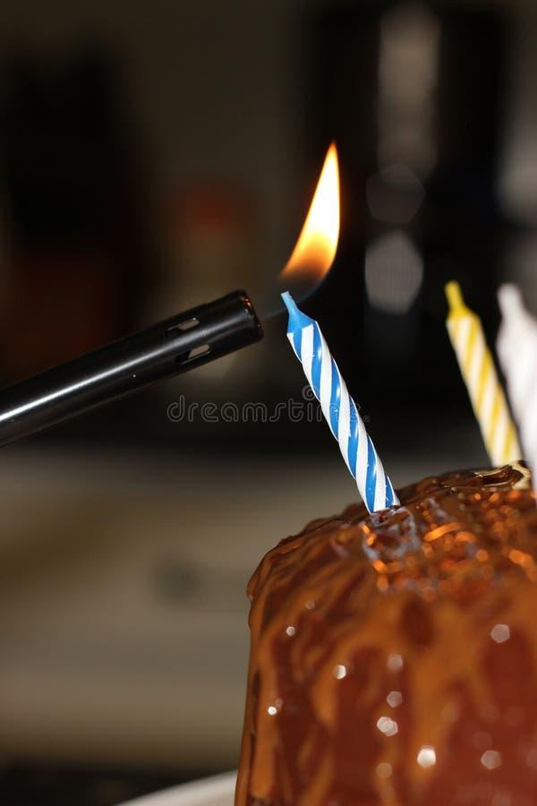 Light Birthday Candle on Cake. Light Birthday Candle on Chocolate Cake stock images