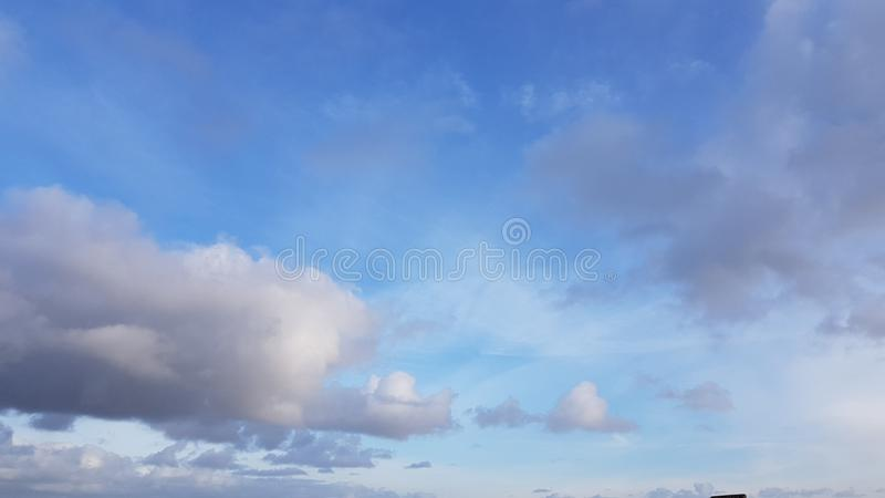 Light Blue Autumn Sky with Clouds royalty free stock photos