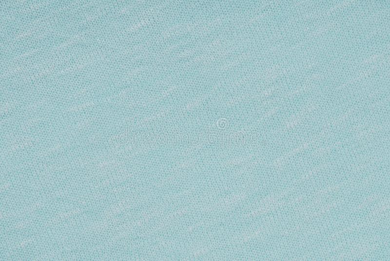 Light blue background stockinette; jersey; tricot; knitted fab royalty free stock images