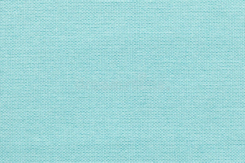 Light blue background from a textile material with wicker pattern, closeup. Structure of the pastel turquoise fabric with natural texture. Cloth backdrop royalty free stock image