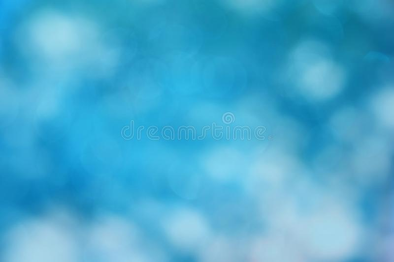 Blue bokeh abstract light background. Light blue color abstract bacground withe blurred defocus bokeh light for template stock photography