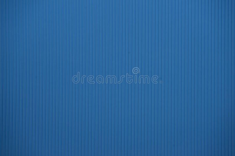 Light blue colored corrugated cardboard texture useful as a background stock photo