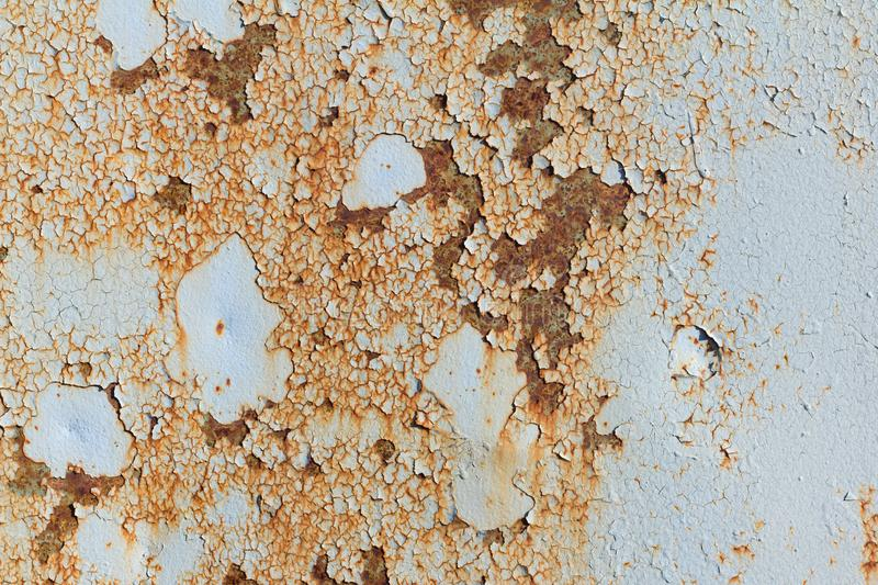 Light blue corroded metal background. Rusty and scratched painted metal wall. Rusty metal background with streaks of rust royalty free stock photos