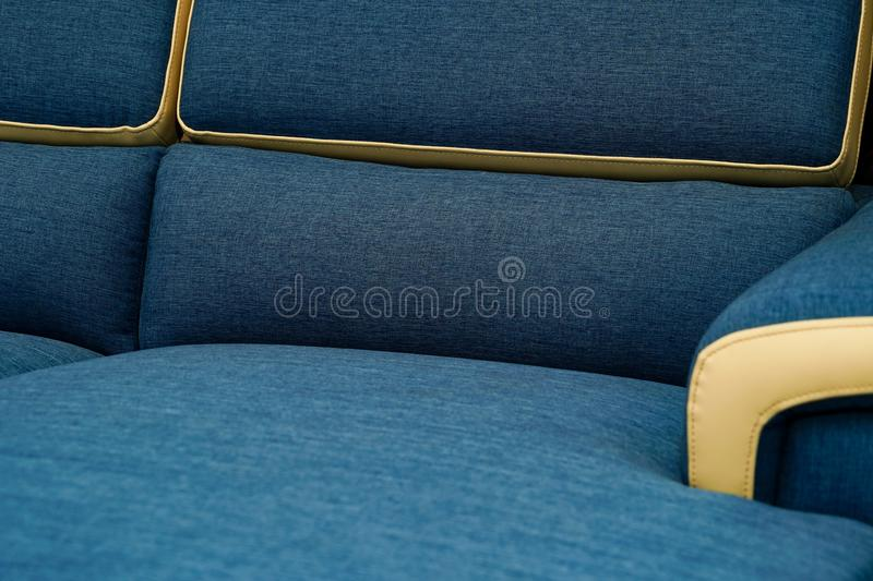 Light blue fabric sofa, close up detail texture. Furniture showroom photography.  royalty free stock photography