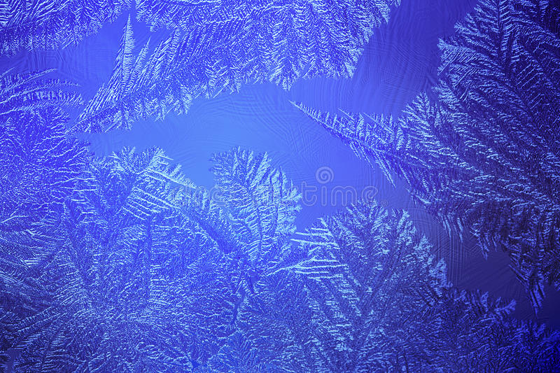 Light blue frosty pattern at a winter stock photos