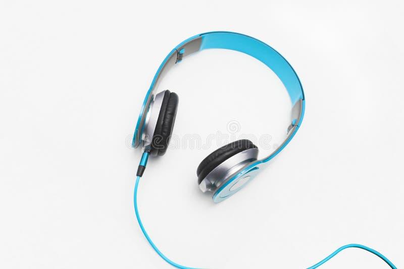 Light blue headphone on white background, isolated. Horizontal stock photo