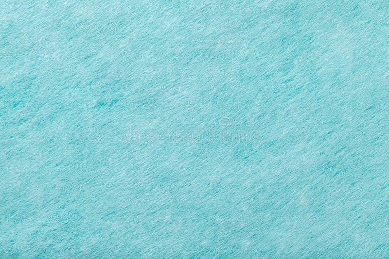 Light blue matt suede fabric closeup. Velvet texture of felt stock image