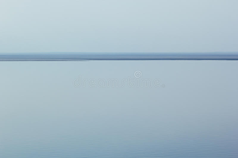 Light blue minimalist landscape with a horizon line. Copy space. Background royalty free stock image