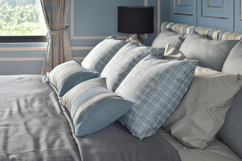 Light blue pillows in difference pattern with classic style bedding. Interior stock photos