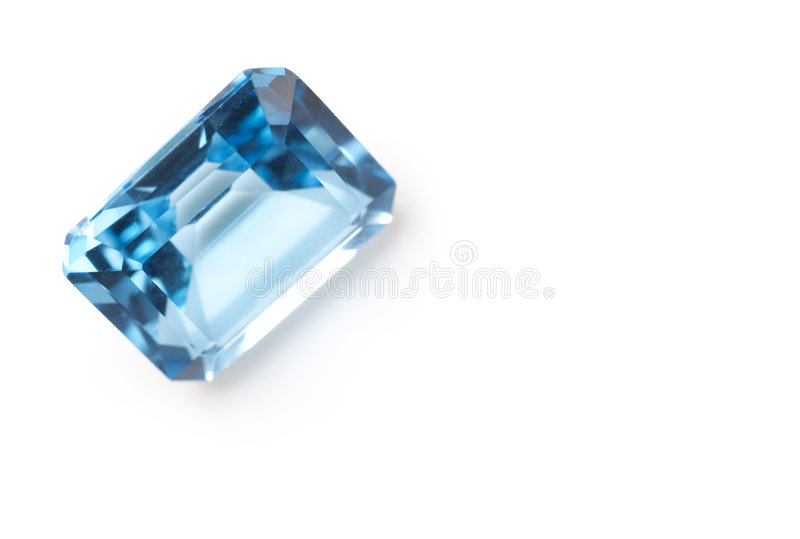 Light blue saphire isolated on white background royalty free stock photography