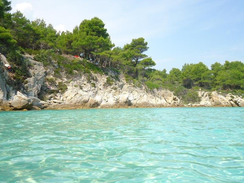 Light blue sea with sea shore in Greece royalty free stock image