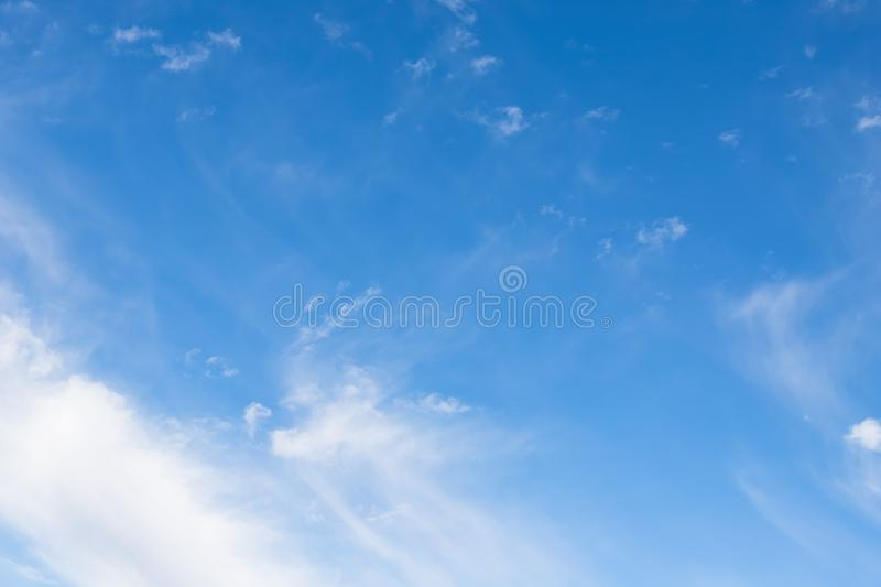 Light blue sky with cirrocumulus clouds. Beautiful sky background stock image