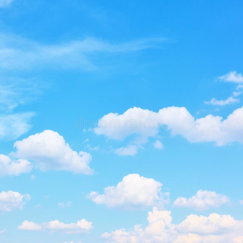 Light blue sky with white clouds stock photo