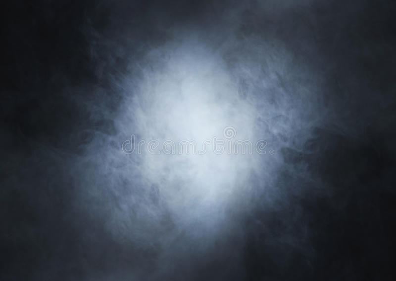Light blue smoke on a deep black background royalty free stock photos