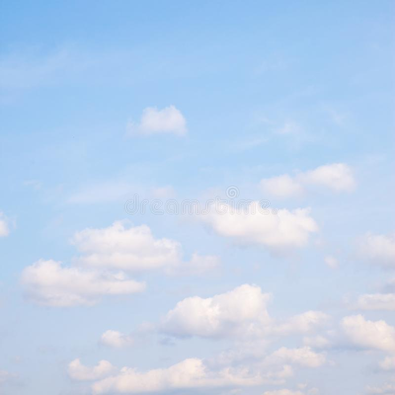 Light blue spring sky with clouds royalty free stock photography